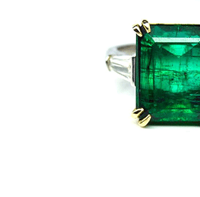 Emerald with step-cut diamond ring